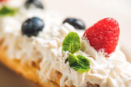 Fresh raspberry on white cream
