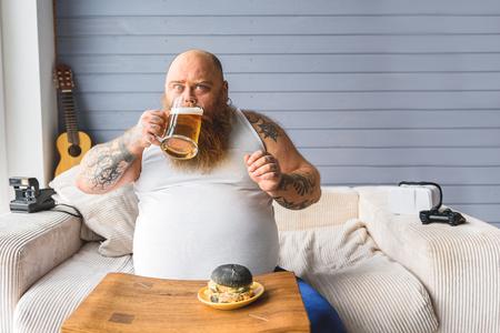 fatso: Greedy fatso swallowing alcoholic drink
