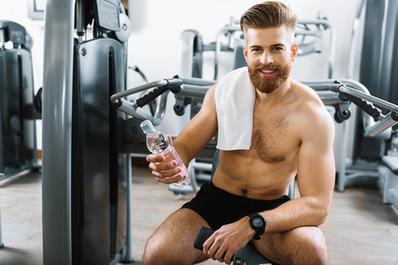 Happy smiling man in gym Stock Photo