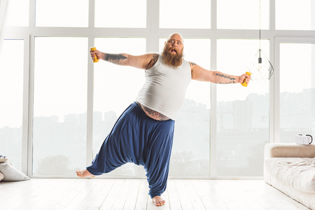 fatso: Shocked male fatso training with weights Stock Photo