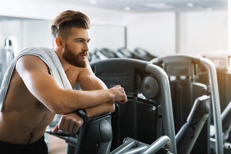 ifestyle: Thoughtful strong man in gymnasium Stock Photo