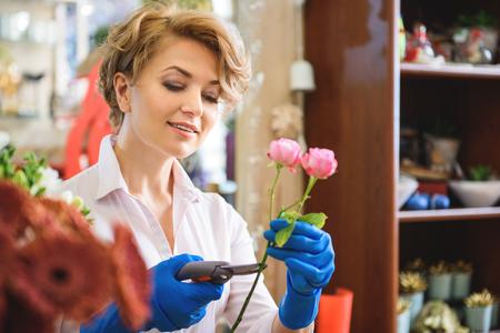 Professional female florist creating bouquet