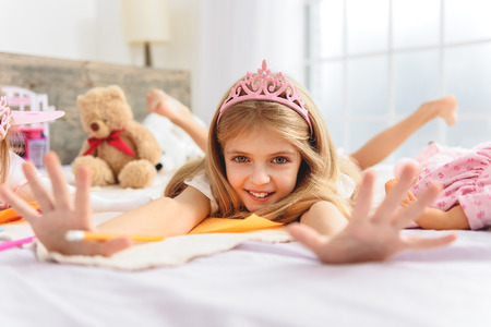 Cute laughing child having fun in bedroom Stock Photo
