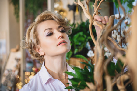 Woman working in flower shop Stock Photo
