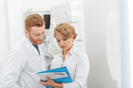 Serious doctors hardly working in clinic Stock Photo