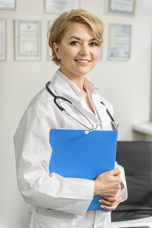 Happy smiling doctor at working place