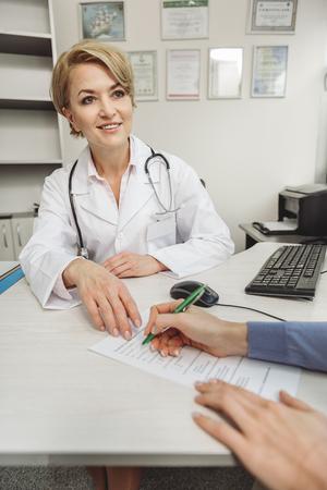 Smiling female medico at work