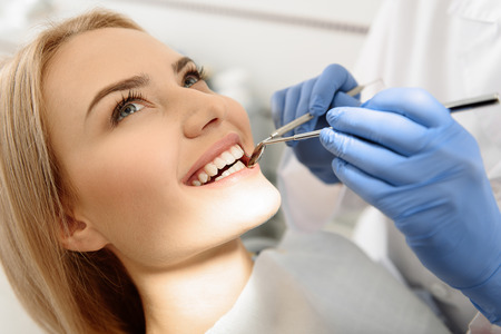 Dentist having view of client teeth Stock Photo