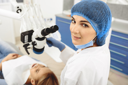Contended stomatologist finishing her work Stock Photo
