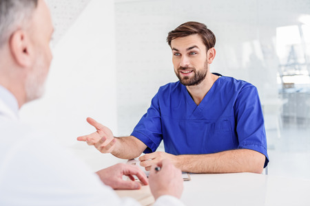 Two medical workers talking at clinic