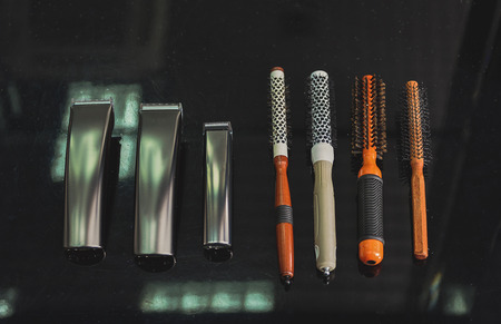 shearer: Different clippers and hairbrushes at barbershop