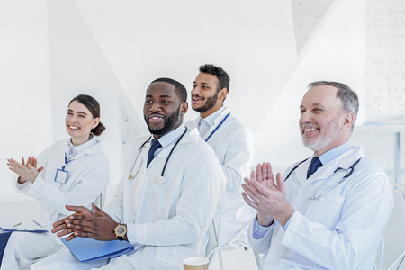 General practitioners applauding to successful lecturer