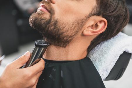shearer: Barber leveling human stubble by shearer