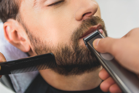 shearer: Professional barber using electric machine for haircut Stock Photo