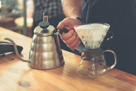 the brewer: Barista measuring degree of boiling water to prepare tasty beverage