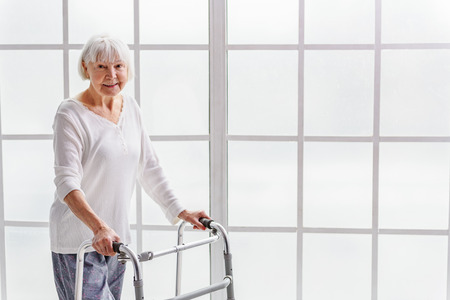 Smiling retiree holding gutter frame in hand Stock Photo - 71097524