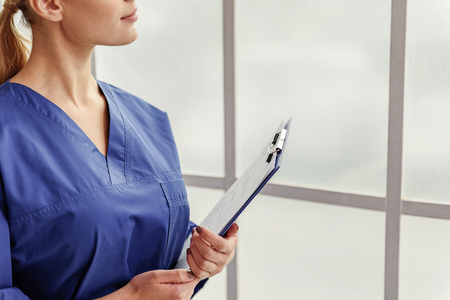surgical department: Physician thinking in apartment of clinic Stock Photo
