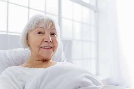 decrepitude: Outgoing pensioner reclining in comfortable cot Stock Photo