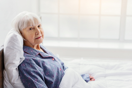 Serene grandmother resting in hospital office Stock Photo - 71097850