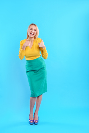 Happy young woman giving thumbs up Stock Photo