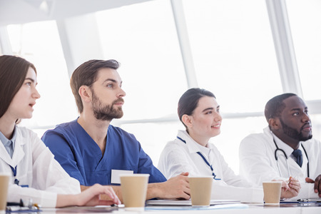 auscultoscope: Attentive therapeutics hearing lecture during in clinic Stock Photo