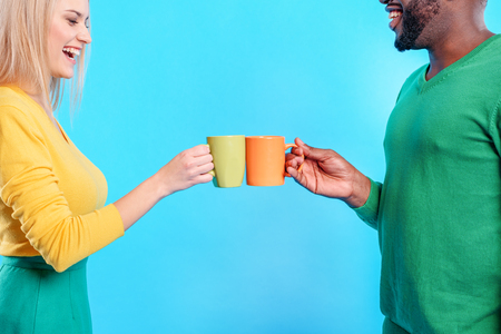 Carefree friends drinking coffee together
