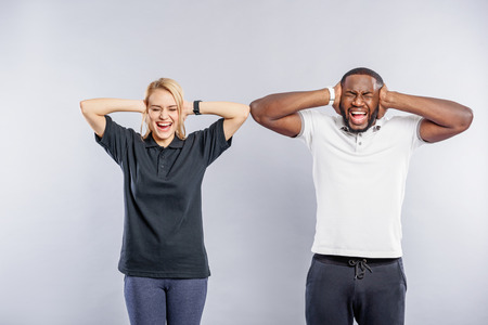 irritation: Guy and girl shouting with irritation