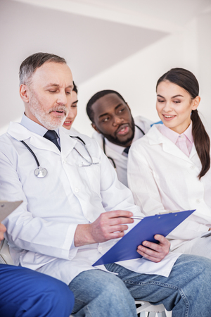 auscultoscope: Thoughtful therapeutic telling what he writing Stock Photo
