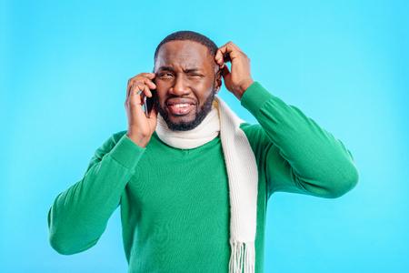Nervous guy talking on smartphone