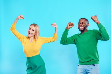 indivisible: Joyful guy and girl expressing positive emotions