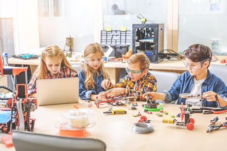 Interested team of young inventors Standard-Bild