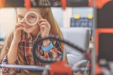 Happy smiling little technician in workshop Stock Photo