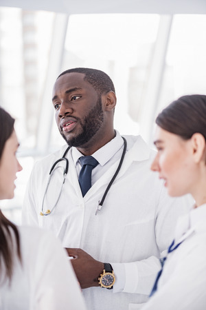 auscultoscope: Serene medical advisers standing in clinic