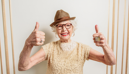 Cheerful old lady showing okay sign