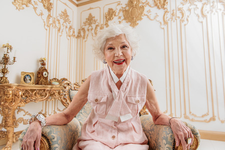 Happy old woman likes luxury life