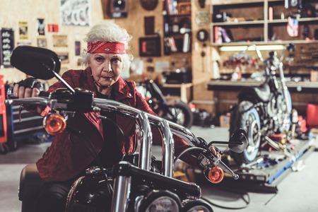 pensioner: Cool pensioner locating on bike
