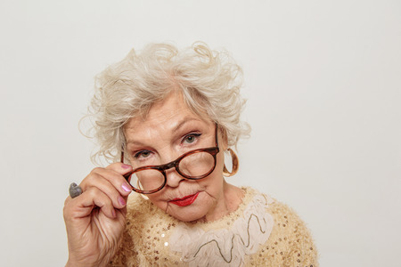 Severe old woman gazing at camera