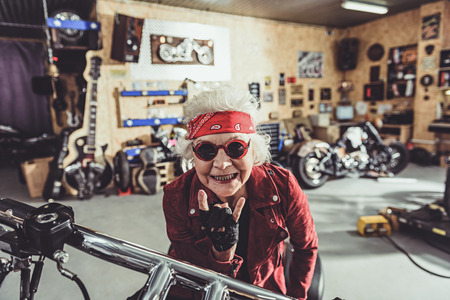 Outgoing female retiree locating on bike
