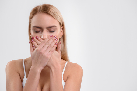 Young woman is dissatisfied with her teeth Stock Photo
