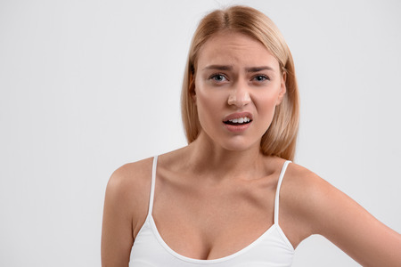 Dissatisfied young woman posing with frustration Stock Photo
