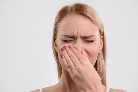 Blond girl dislikes terrible smell Stock Photo