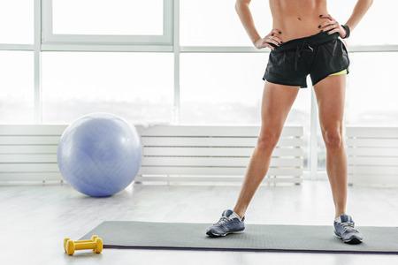 Sportive woman in light gym