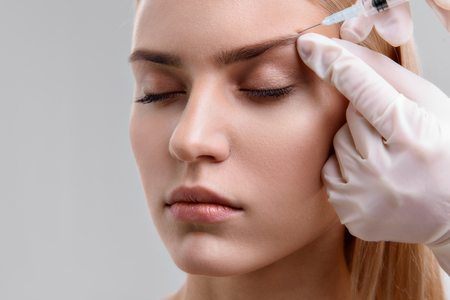serine: Serine lady having rejuvenation procedure Stock Photo