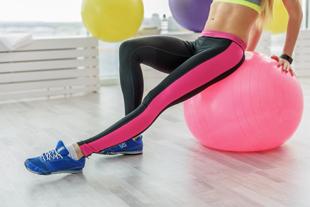 Taut young woman in fitness club Stock Photo