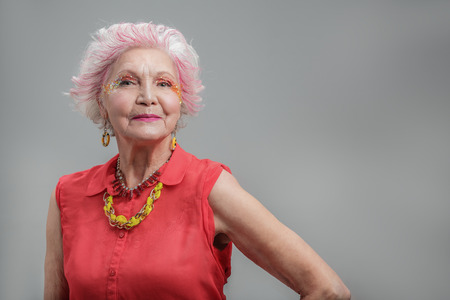 Smiling senior woman with fashionable hairstyle