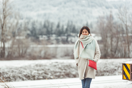 Cheerful female walking outdoors in winter Stock Photo