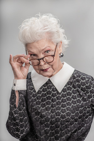 Middle aged female with skeptical expression on her face Stock Photo