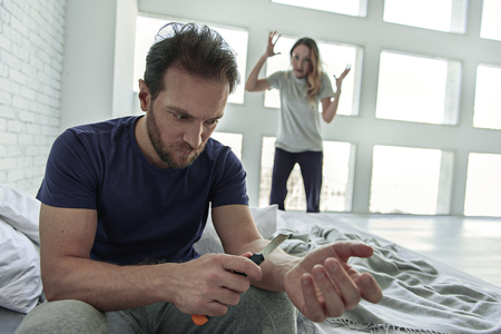 commit: Despaired male person keeping knife Stock Photo