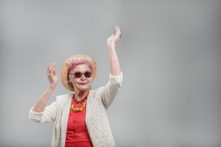 Emotional elderly woman wearing sunglasses Stock Photo