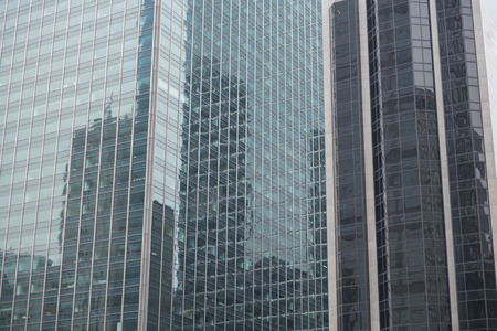 Mirror tall buildings locating opposite each other